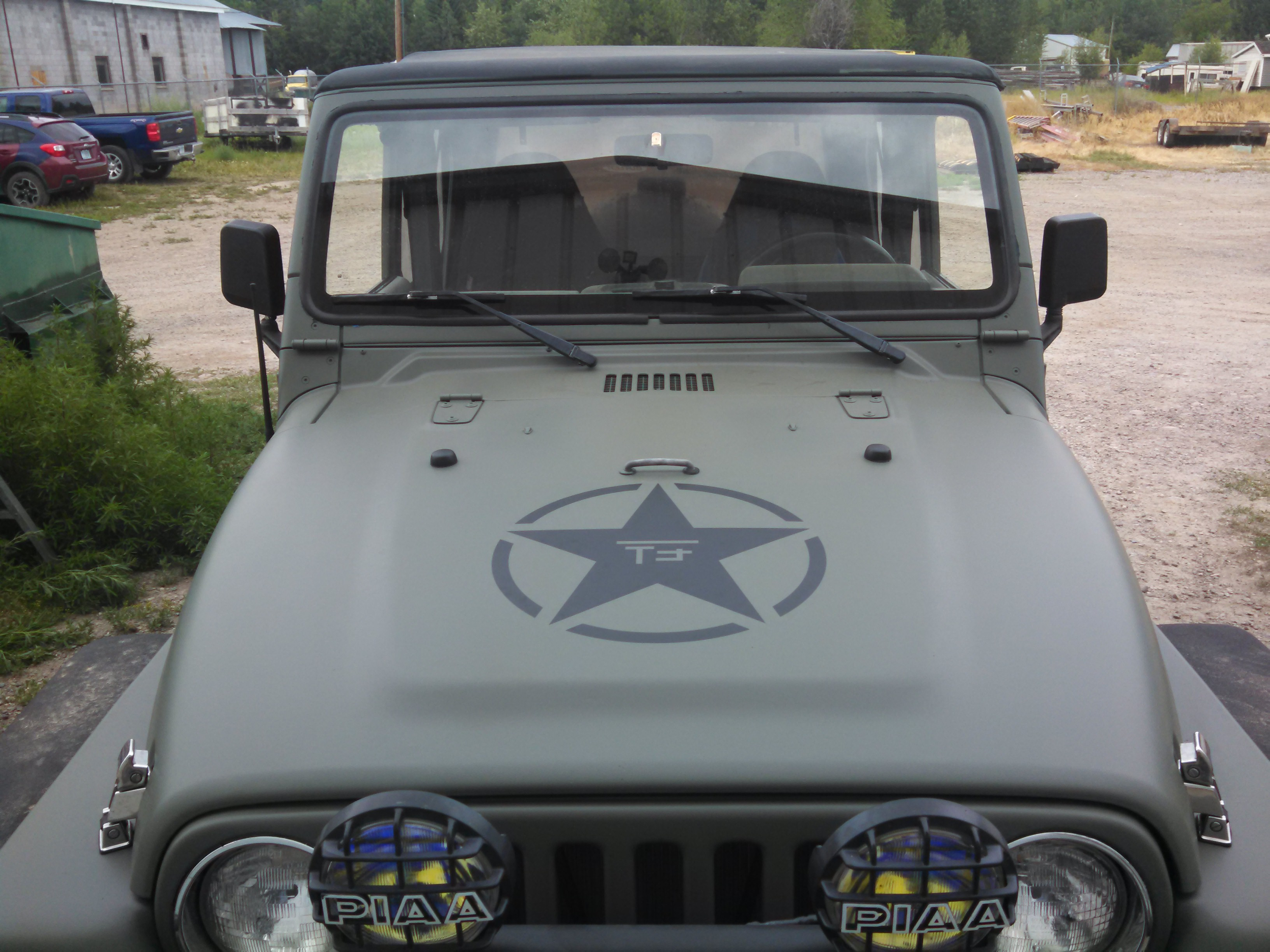 Olive Drab Jeep graphics installed